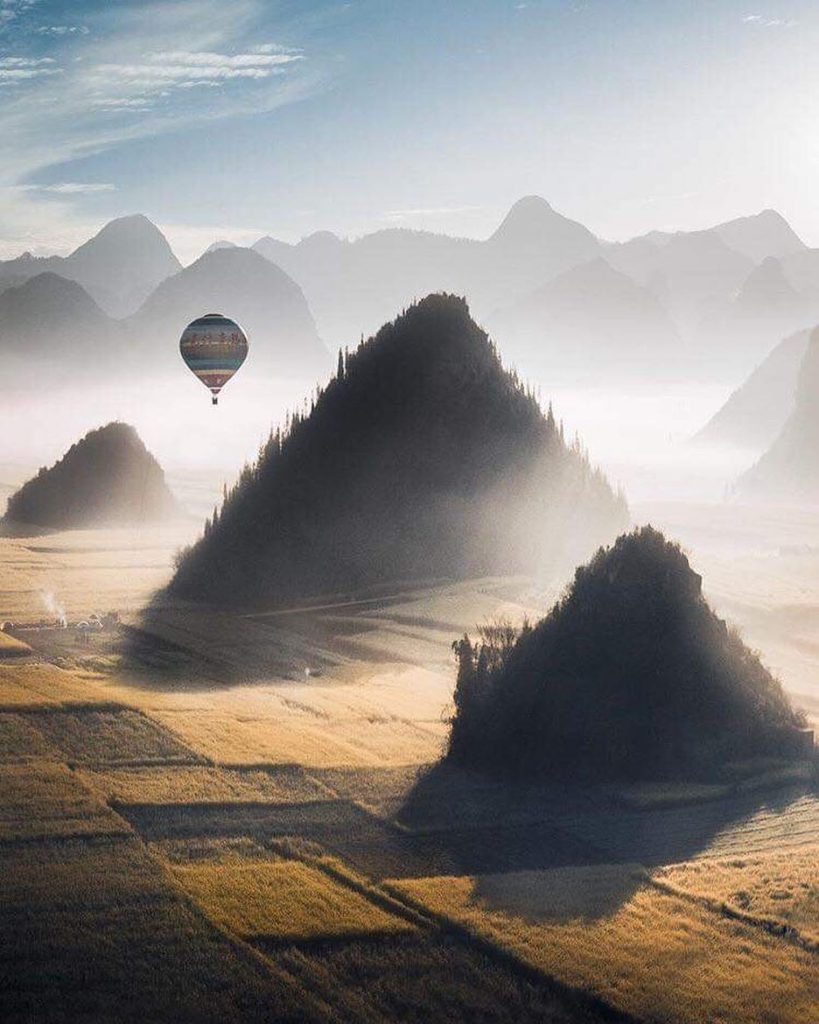 A beautiful image of this air ballon rising over the mist! Stunning!  Photograph...