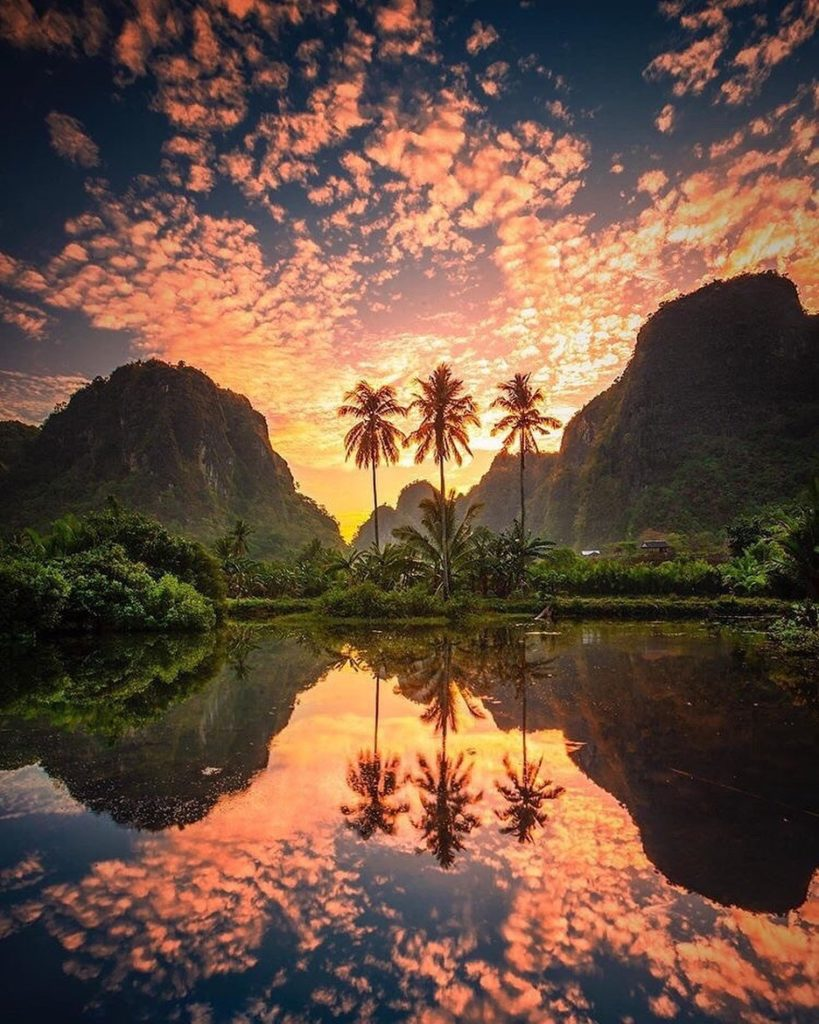 What a beautiful sunset and reflection from Indonesia! Just stunning!  Photograp...