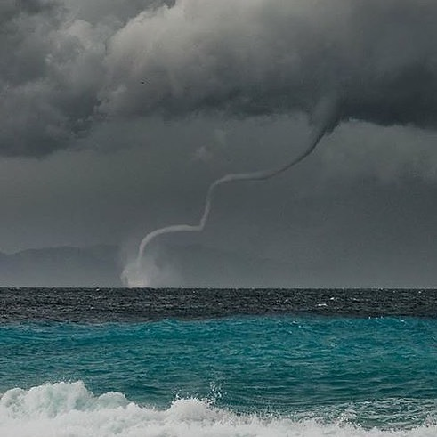 An amazing waterspout in Greece!  Photography | @stevekesman_photography  Curate...